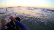 Stock Video Footage of A POV shot from the vantage point of a windsurfer moving across waves.