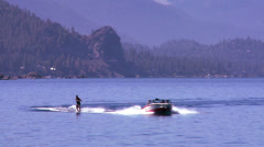A water skier moves across the clear waters of Lake Tahoe, Nevada. Stock Footage