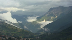 Valley + low clouds in Swiss Alps - Unterengadin Scuol Stock Footage