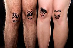 four funny legs showing friendship - stock photo