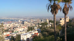 Establishing shot overlooking apartments and buildings and the Baha'i Temple in Stock Footage