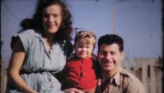 810 - small family pose for the camera - vintage film home movie Stock Footage