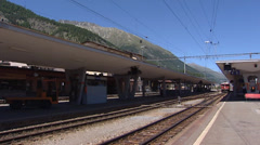 SAMEDAN, SWITZERLAND: Rhaetian Railway Train arrives at railway station. - stock footage
