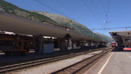 Stock Video Footage of SAMEDAN, SWITZERLAND: Rhaetian Railway Train arrives at railway station.