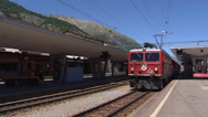 Stock Video Footage of SAMEDAN, SWITZERLAND - Rhaetian Railway Train departs from railway station