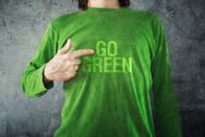 Stock Photo of go green. man pointing to title printed on his shirt