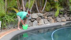 Man Salts Swimming Pool Stock Footage