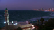 Stock Video Footage of Modern buildings of Tel Aviv, Israel at night with beach and ocean nearby and