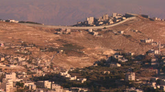 The new security wall marking Israel from palestine moves across the distant Stock Footage