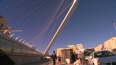 Tilt up to a huge bridge in the form of a harp greets visitors in the new city Stock Footage