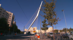 Traffic moves near a huge bridge in the form of a harp greets visitors in the Stock Footage