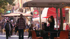 Pedestrians crowd the cafes and modern streets in the new city of Jerusalem, - stock footage