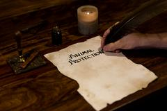 man writes on a parchment animal protection - stock photo
