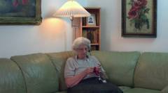 Grandmother crocheting, traditional handcraft, hobby, recreational activity - stock footage