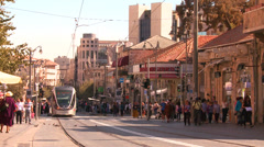 An electric tram moves through the new city of Jerusalem, israel. Stock Footage