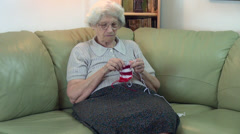 Grandmother knitting, traditional handcraft, hobby, zoom in Stock Footage