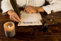 Man writes a contract Stock Photos