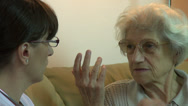Stock Video Footage of Home health care female doctor observing old patient eye's