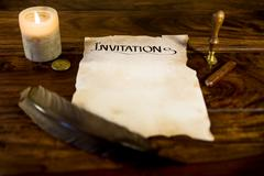 Parchment manuscript with the word invitation Stock Photos
