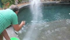 Salting A Swimming Pool Stock Footage