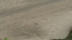 People on a Beach in Wales Stock Footage