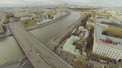Cars ride by Kotelnicheskaya quay and cityscape Stock Footage