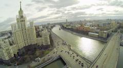 Cars ride by bridge and Kotelnicheskaya embankment Stock Footage