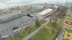 Traffic on quay of Moskva river branch and many buses Stock Footage