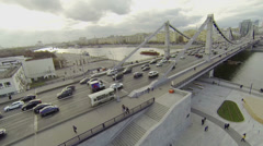 People walk by quay near Crimean bridge with traffic Stock Footage