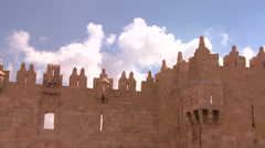 A timelapse shot of clouds moving over the gates and walls of the Old City of Stock Footage
