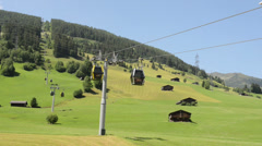 Pod of Iskogel cable car goes down into the valley Stock Footage