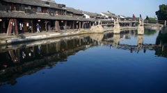 Traditional Chinese houses & bridge reflection on blue water,XiTang Water Town. Stock Footage