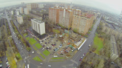 Cars ride by roundabout on Square of Bela Kun at autumn day Stock Footage