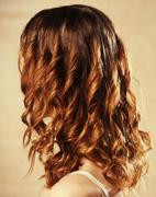 Female curly red hairs - back view Stock Photos