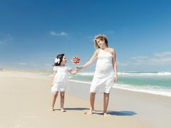 Mother and daughter holding a windmill Stock Photos