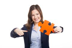 business woman holding a puzzle piece - stock photo