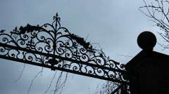 Spooky entrance gate to mansion - dolly shot - stock footage