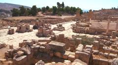 Tourists walk amongst the ruins of Jerash, Jordan. Stock Footage