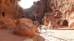 Horsecarts pass through the narrow canyons leading up to Petra in Jordan. Stock Footage