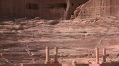 Sheep and goats walk around the ancient amphitheater in Petra, Jordan. Stock Footage