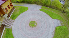 Round pavement on yard near wooden house at autumn day Stock Footage