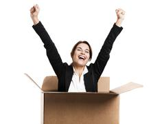Business woman appear inside a big card box Stock Photos