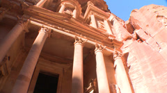 Low angle view of the facade of the Treasury building in the ancient Nabatean - stock footage