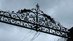 Mansion gate crest on atmospheric day - zoom Stock Footage