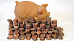 Pig-shaped Piggy Bank and coin stacks that disappear. Concept of saving Stock Footage