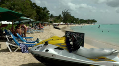 Barbados Paynes bay 029 wide view over the beach, a jet ski in foreground Stock Footage