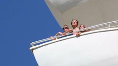 Family of three on the balcony of the room at the hotel Stock Footage