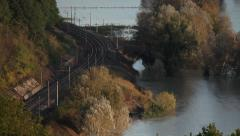 Train passing over the lake Stock Footage