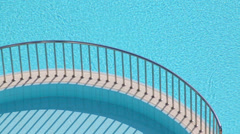 Two swimming pools and separating ledge with steel handrails Stock Footage