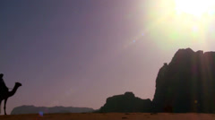 A camel train crosses the Saudi desert in Wadi Rum, Jordan. Stock Footage